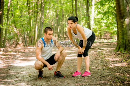 couple relaxes after jogging