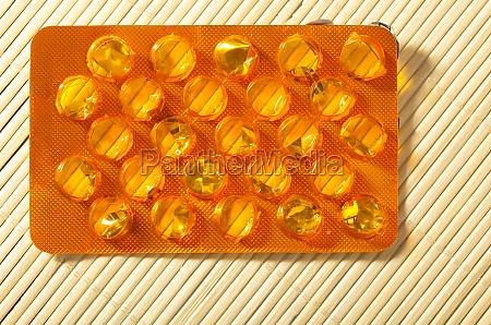 orange package of pills drug medicine