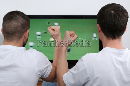 young people watch football on tv