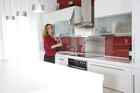 young beautiful woman in modern kitchen