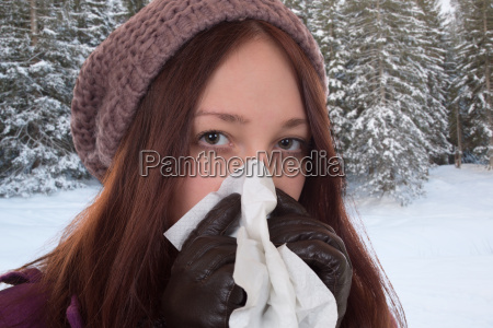 young woman has a cold or