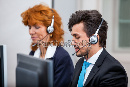 friendly consultants on the telephone with