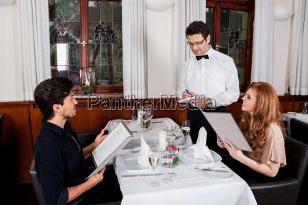 happy adult couple in the restaurant