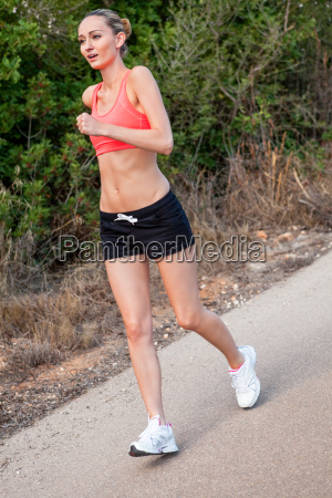 young attractive sporty woman jogging while