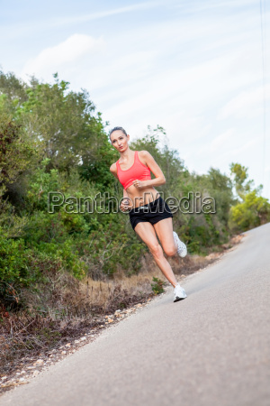 young attractive sporty woman while running