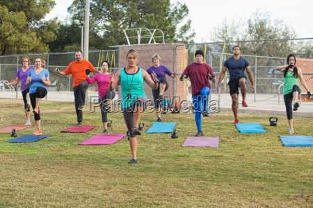 instructor exercising with group