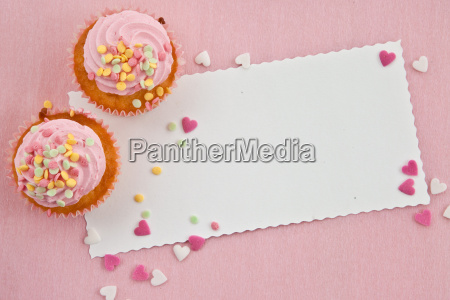 small cupcakes on pink