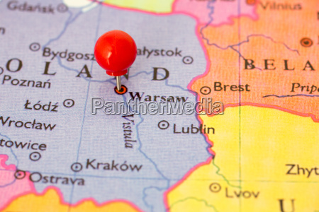 red pushpin on map on poland