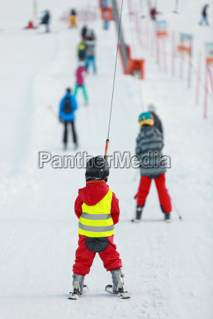 child with red ski suit on