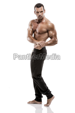muscle man posing in studio isolated