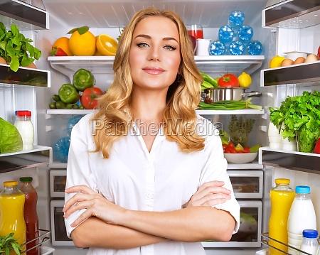 healthy woman near open fridge