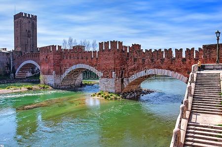 famous red brick castelvecchio bridge across