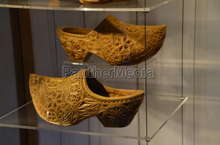 wooden shoes in a glass cabinet