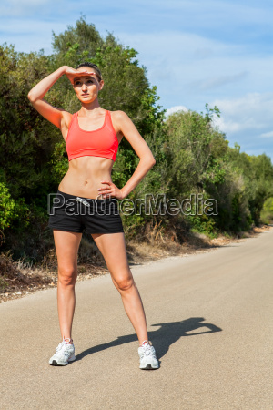 young woman jogging workout in summer