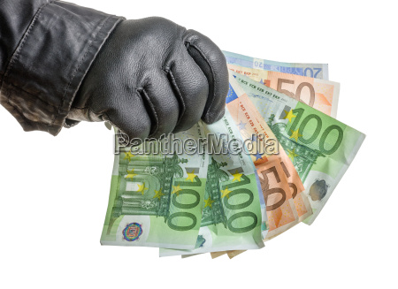 thief with leather glove reaching for