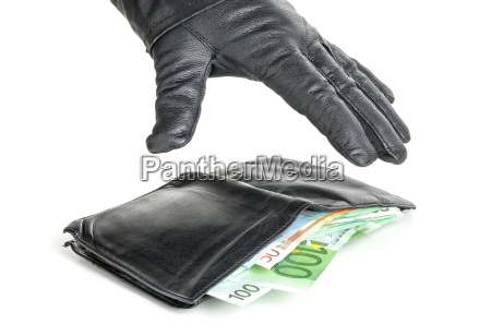 thief with leather glove grabs a