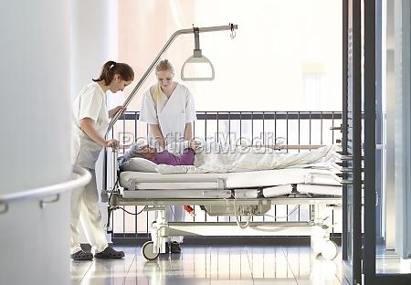 nurse patient hallway bed