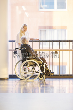 nurse wheelchair patient conversation