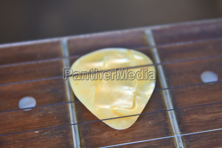 guitar pick on the fingerboard