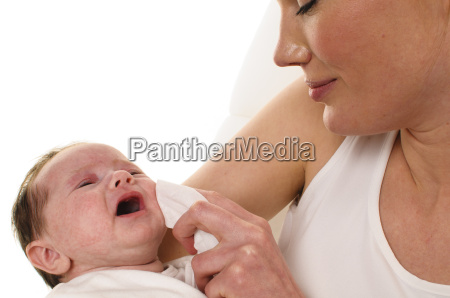 mother with infant and towel