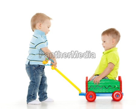 children are playing with toy car