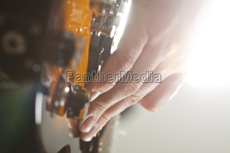 close up on mans hand playing