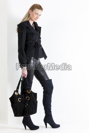 standing woman wearing black clothes with