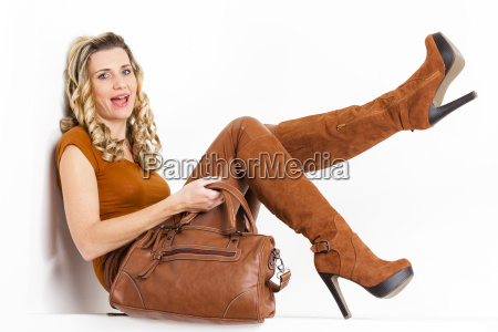 sitting woman wearing brown clothes and
