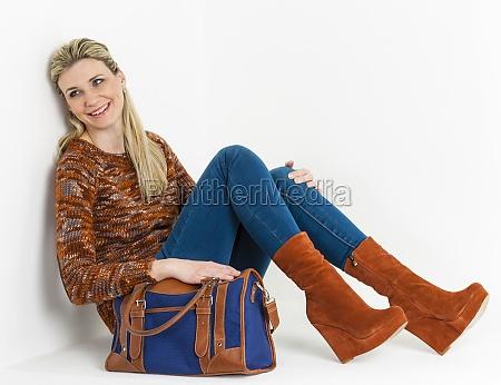 sitting woman wearing fashionable platform brown