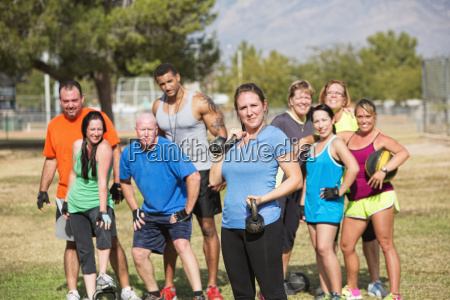 young woman exercising with group