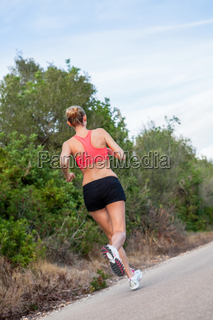 young attractive athletic woman running jogging