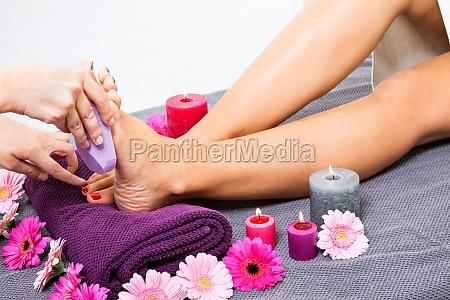 woman having pedicure at a beauty