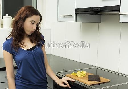 young woman looking at unhealthy food