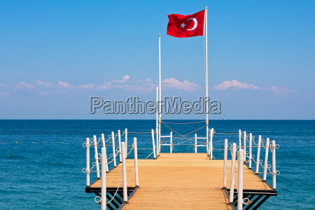 small wooden pier and red national