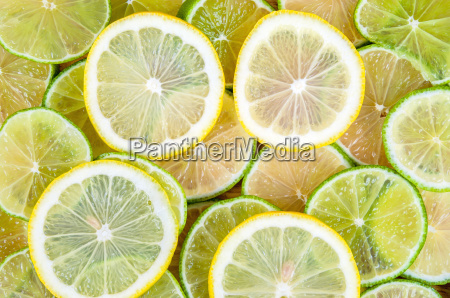 background of lime and lemon slices