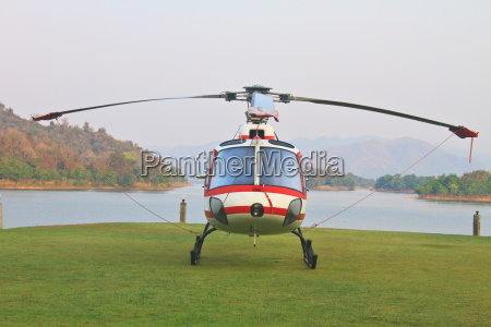 helicopter standing on landing strip in