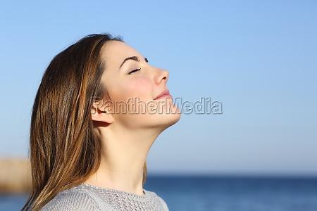 woman portrait breathing deep fresh air