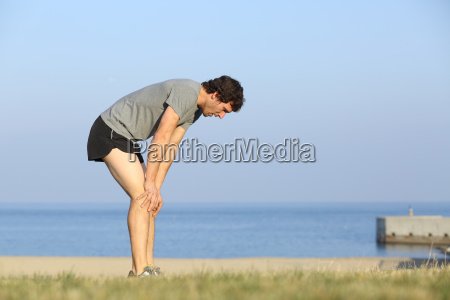 exhausted runner man resting on the