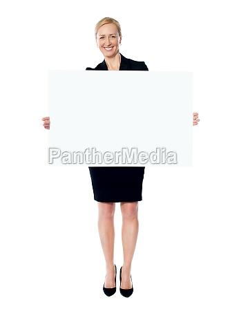 female business promoter holding white blank