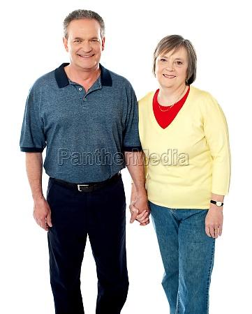 happy matured couple posing