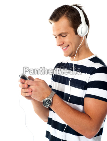 male teenager with mp3 player and