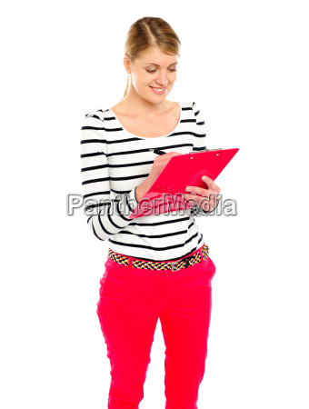young girl writing makes notes on