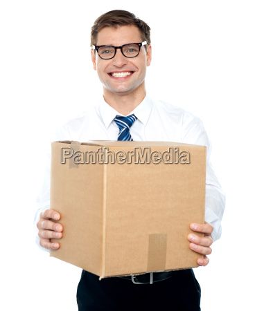 businessman holding packed carton