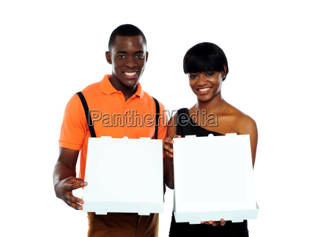 beautiful young couple with pizza boxes
