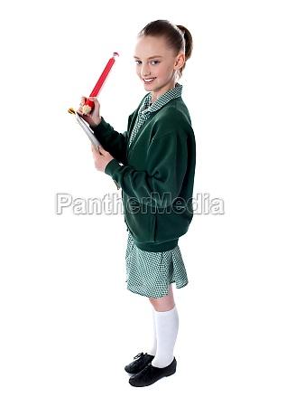 school girl drawing with big pencil