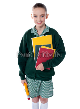 school girl standing with notebooks