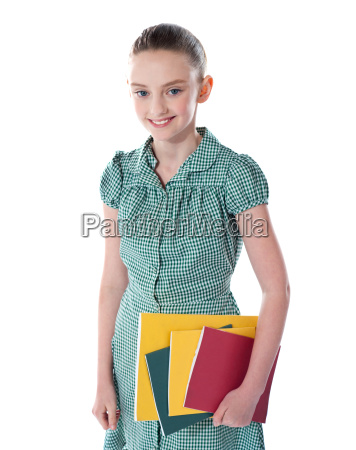 school girl carrying books in hand