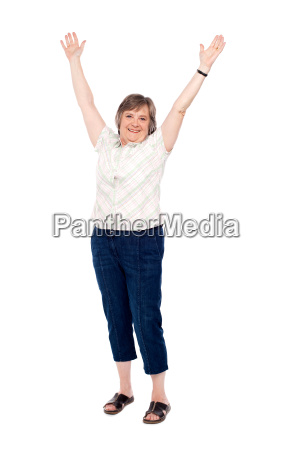 cheerful senior woman lifting her arms