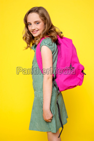 pretty school girl carrying pink backpack