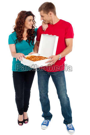 love couple sharing pizza enjoying together